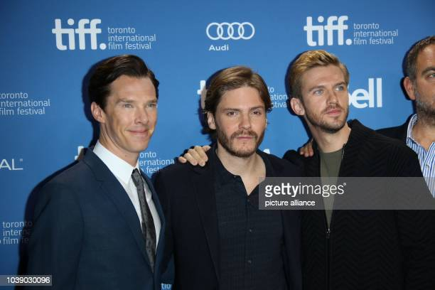 Actors Benedict Cumberbatch Daniel Bruehl and Dan Stevens attend the photo call of 'The Fifth Estate' during the Toronto International Film Festival...