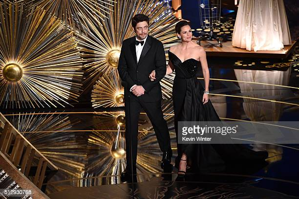Actors Benicio del Toro and Jennifer Garner walk onstage during the 88th Annual Academy Awards at the Dolby Theatre on February 28 2016 in Hollywood...