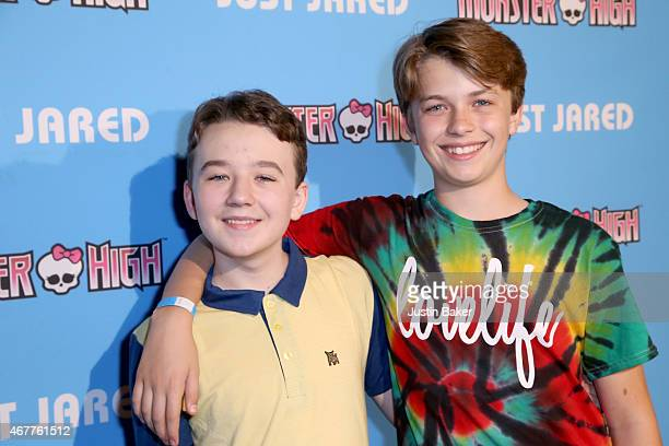 Actors Benjamin Stockham and Jacob Hopkins attend Just Jared's Throw Back Thursday Party at Moonlight Rollerway on March 26 2015 in Glendale...