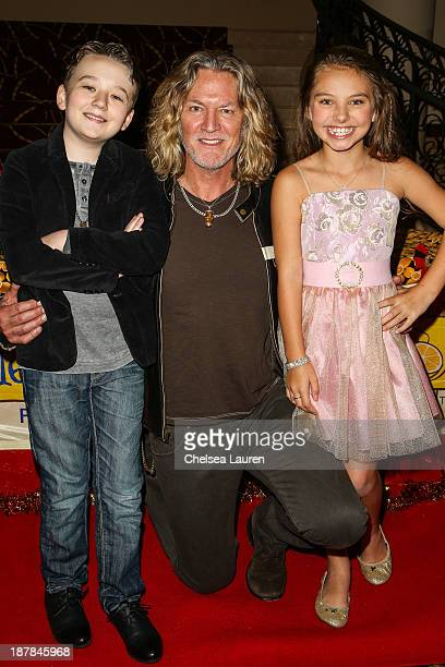 Actors Benjamin Stockham William Shockley and Caitlin Carmichael arrive at A Country Christmas VIP screening hosted by miss Caitlin Carmichael to...