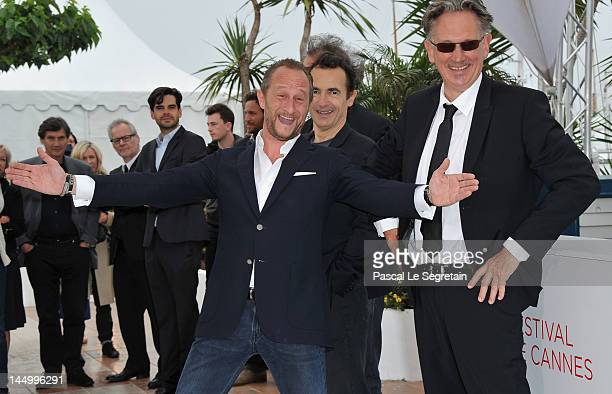 Actors Benoit Poelvoorde Albert Dupontel and director Benoit Delepine at the 'Le Grand Soir' photocall during the 65th Annual Cannes Film Festival at...