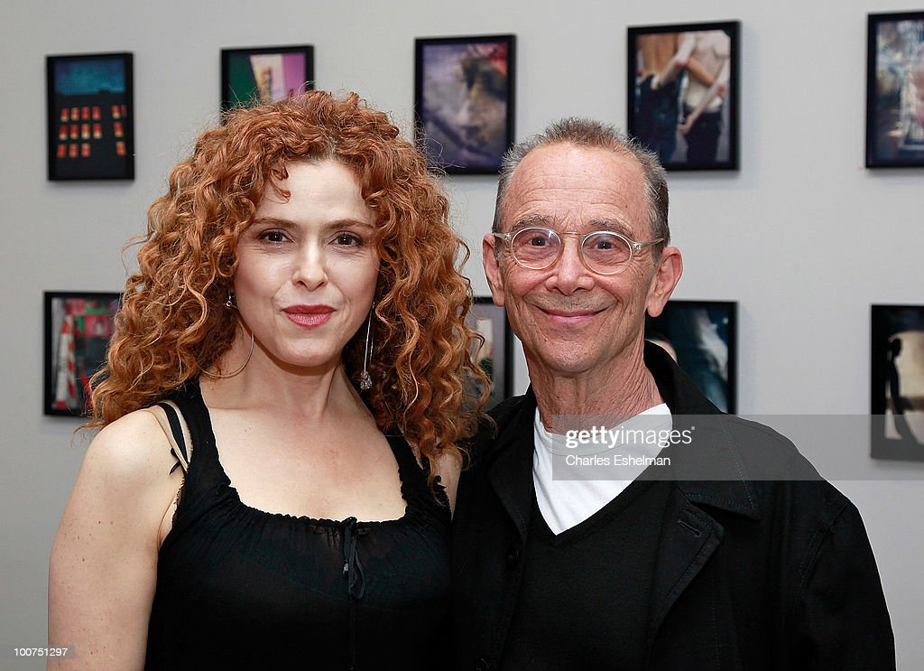 Actors Bernadette Peters and Joel Grey attend the photography exhibition opening for '1.3: New Color Images by Joel Grey' at Steven Kasher Gallery on May 25, 2010 in New York City.