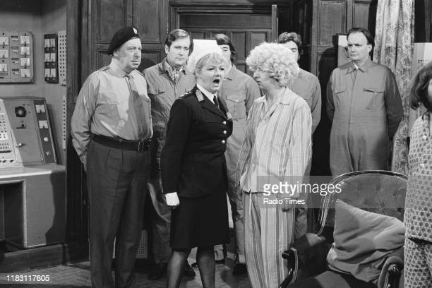 Actors Bill Fraser and Joan Sims with comedian Tim BrookeTaylor in a sketch from episode 'Way Outward Bound' of the BBC television series 'The...