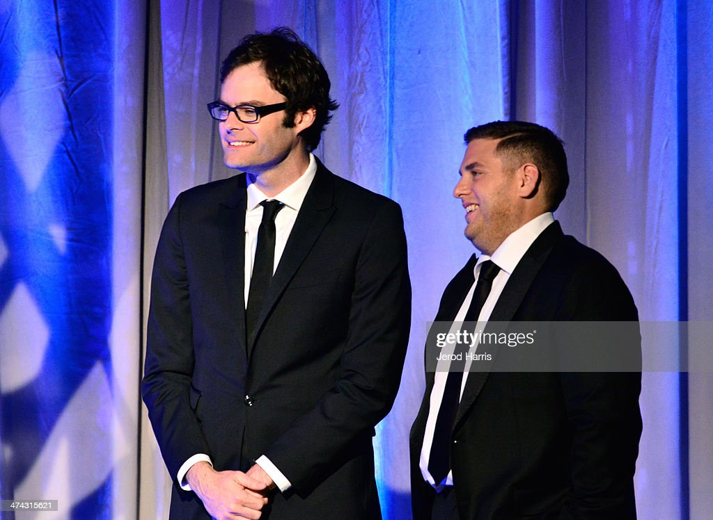 Actors Bill Hader (L) and Jonah Hill present onstage during the 16th Costume Designers Guild Awards with presenting sponsor Lacoste at The Beverly Hilton Hotel on February 22, 2014 in Beverly Hills, California.