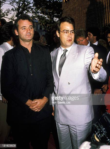 Actors Bill Murray and Dan Aykroyd attend the premiere of Ghostbusters on June 7 1984 at the Avco Cinema Theater in Westwood California