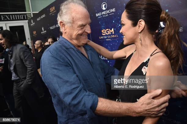 Actors Bill Smitrovich and Autumn Reeser attend the world premiere of 'Valley Of Bones' at ArcLight Hollywood on August 24 2017 in Hollywood...