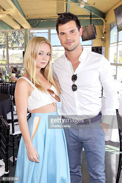 Actors Billie Lourd and Taylor Lautner at the 2016 Breeders' Cup World Championships at Santa Anita Park on November 5 2016 in Arcadia California
