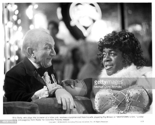Actors Billy Barty and Flip Wilson in a scene from the movie Skatetown USA circa 1979