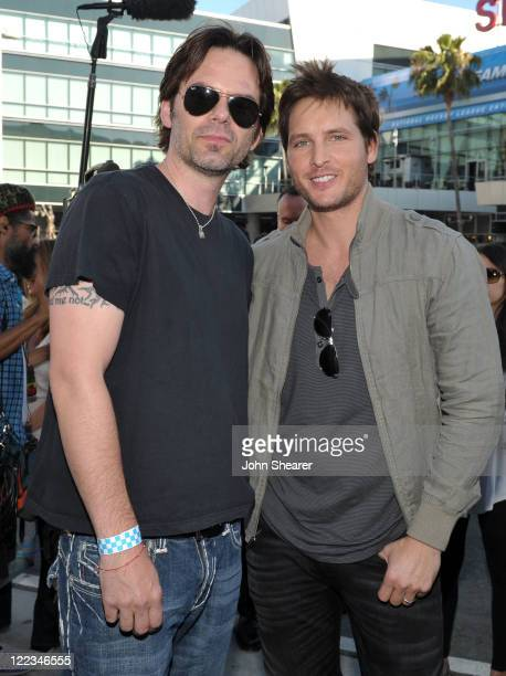 Actors Billy Burke and Peter Facinelli pose during the 2010 Los Angeles Film Festival at Nokia Plaza on June 23 2010 in Los Angeles California