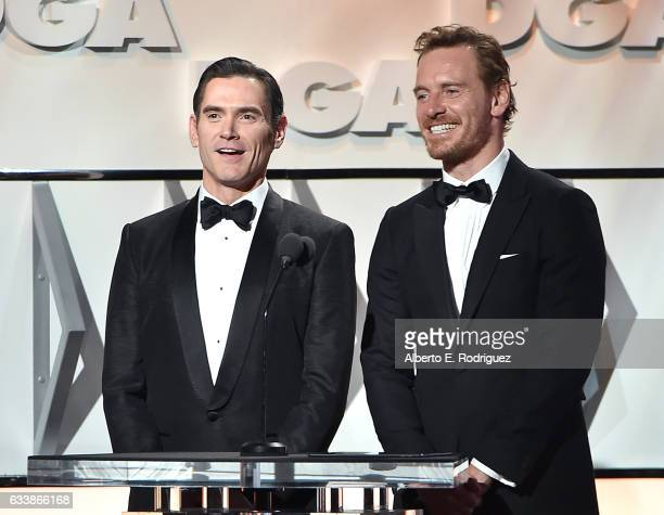 Actors Billy Crudup and Michael Fassbender speak onstage during the 69th Annual Directors Guild of America Awards at The Beverly Hilton Hotel on...