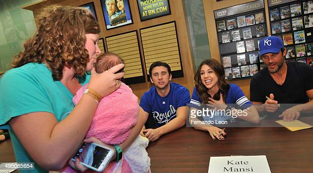 Actors Billy Flynn Kate Mansi and Greg Vaughan greet one of their fans during the Days Of Our Lives book signing at the Oak Park Mall Barnes And...