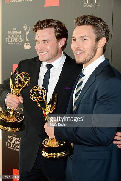 """Actors Billy Miller and Scott Clifton pose with the Outstanding Supporting Actor in a Drama Series award for """"The Young and the Restless"""" and """"The..."""
