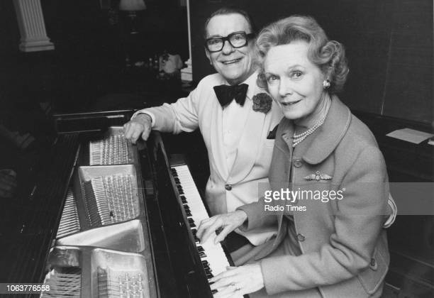Actors Billy Milton and Dame Anna Neagle pictured sitting at a piano together February 13th 1978