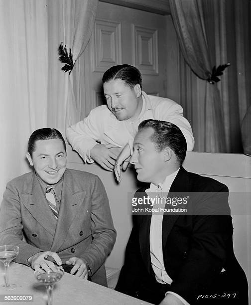 Actors Bing Crosby and Don Ameche sitting at a table together for Paramount Pictures 1942