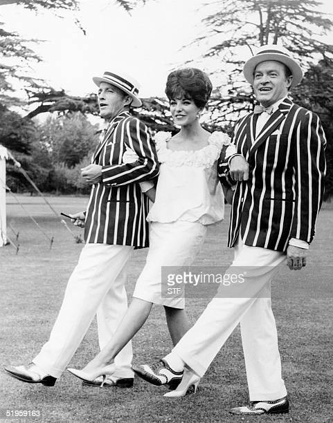 US actors Bing Crosby Joan Collins and Bob Hope perform a dance during the footage of a film in the Sheppertons's studios near London 04 August 1961...