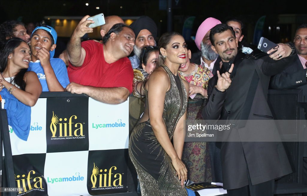 Actors Bipasha Basu and Karan Singh Grover pose with the fans attend the 2017 International Indian Film Academy Festival at MetLife Stadium on July...