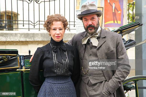 Actors Birgit Minichmayr as Bertha von Suttner and Sebastian Koch as Alfred Noble pose during the 'Madame Nobel' set visit on May 26 2014 in Vienna...