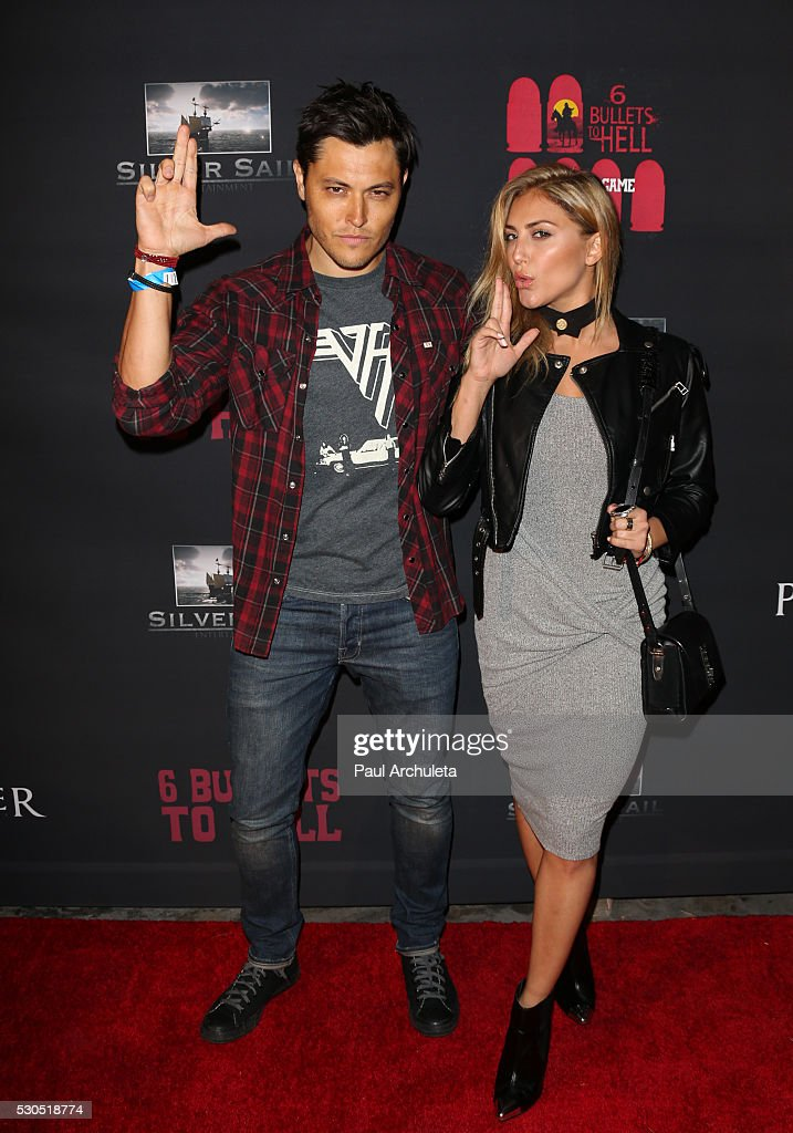 Actors Blair Redford (L) and Cassie Scerbo (R) attend the launch of '6 Bullets To Hell' the video game and the movie on May 10, 2016 in Los Angeles, California.