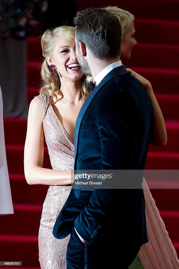Actors Blake Lively (L) and Ryan Reynolds attend the 'Charles James: Beyond Fashion' Costume Institute Gala at the Metropolitan Museum of Art on May 5, 2014 in New York City.