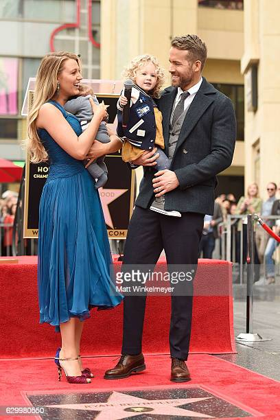 Actors Blake Lively and Ryan Reynolds pose with their daughters as Ryan Reynolds is honored with star on the Hollywood Walk of Fame on December 15...