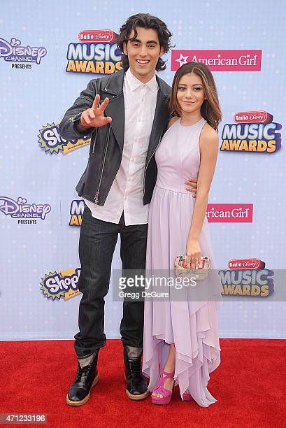 Actors Blake Michael and G Hannelius arrive at the 2015 Radio Disney Music Awards at Nokia Theatre LA Live on April 25 2015 in Los Angeles California