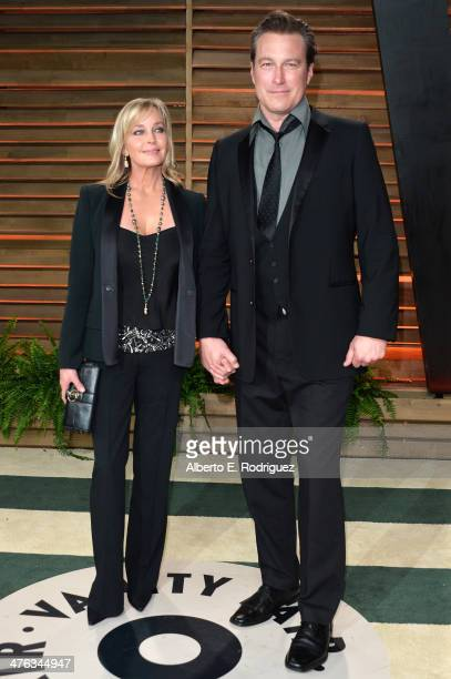 Actors Bo Derek and John Corbett attend the 2014 Vanity Fair Oscar Party hosted by Graydon Carter on March 2 2014 in West Hollywood California