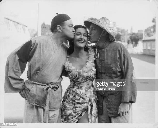 Actors Bob Hope and Frank Sinatra kissing the cheek of actress Dorothy Lamour on the set of the movie 'Road to Hong Kong' at Shepperton Studios...