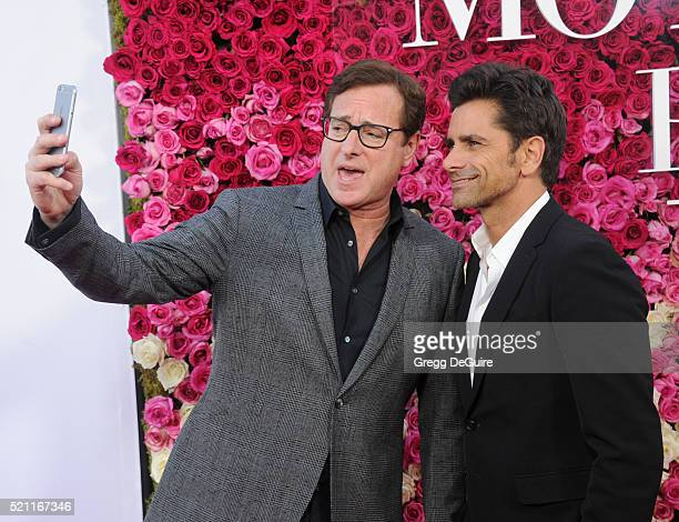 Actors Bob Saget and John Stamos arrive at the Open Roads World Premiere Of Mother's Day at TCL Chinese Theatre IMAX on April 13 2016 in Hollywood...