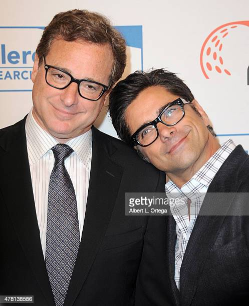 Actors Bob Saget and John Stamos arrive for 'Cool Comedy Hot Cuisine' To Benefit The Scleroderma Research Foundation held at the Beverly Wilshire...