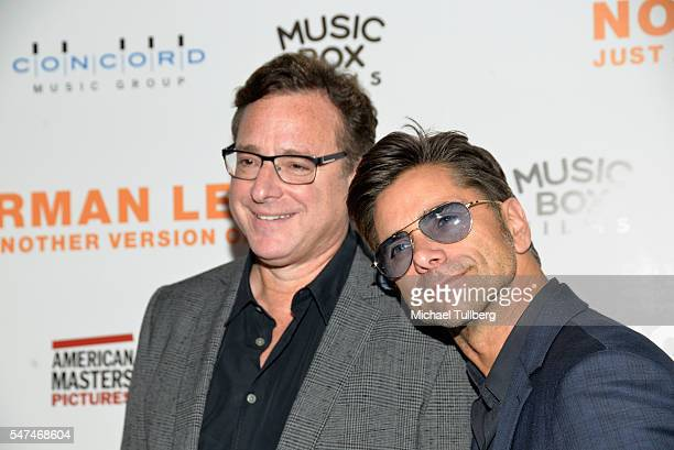 """Actors Bob Saget and John Stamos attend the premiere of Music Box Films' """"Norman Lear: Just Another Version Of You"""" at The WGA Theater on July 14,..."""