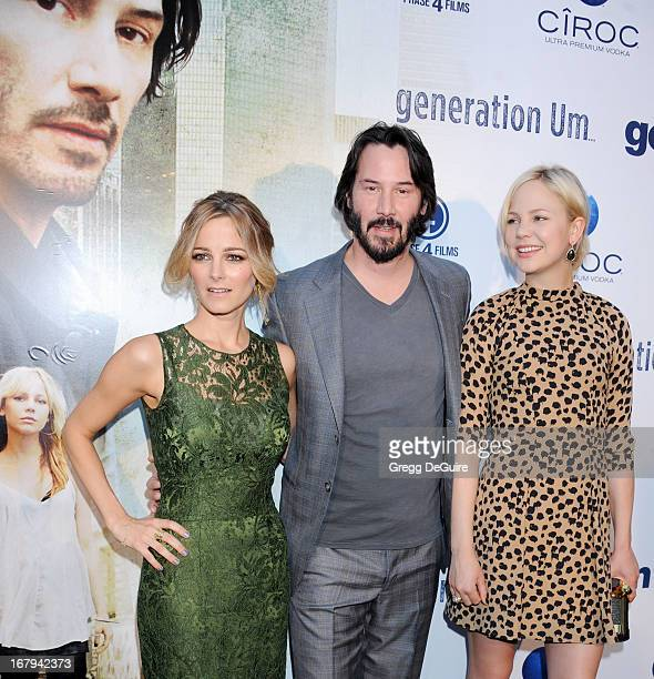 Actors Bojana Novakovic Keanu Reeves and Adelaide Clemens arrive at the Los Angeles premiere of 'Generation UM' at ArcLight Hollywood on May 2 2013...