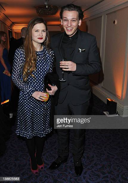 Actors Bonnie Wright and Jamie Campbell Bower attend the Orange British Academy Film Awards 2012 after party at Grosvenor House on February 12 2012...