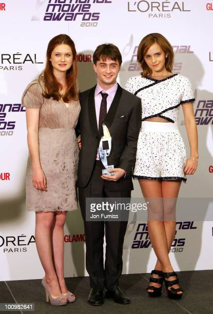 Actors Bonnie Wright Daniel Radcliffe and Emma Wastson pose in front of the winners' boards at the National Movie Awards 2010 at the Royal Festival...
