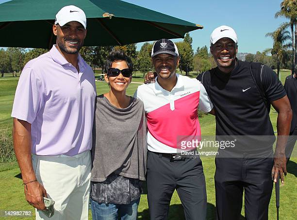 Actors Boris Kodjoe Halle Berry Dondre Whitfield and Flex Alexander attend the 4th annual Halle Berry Celebrity Golf Classic at Wilshire Country Club...