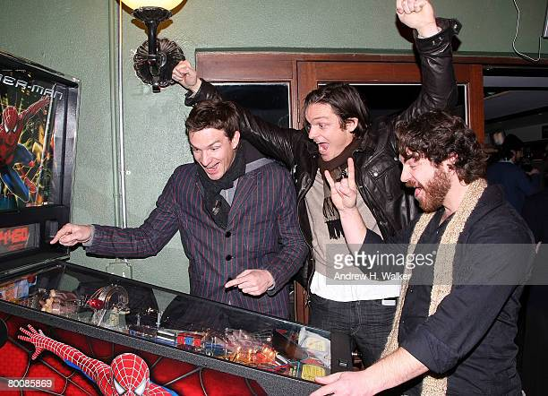 Actors Brad Johnson Bart Johnson and Adam Johnson play pinball at the after party of the premiere of Happy Valley at 6th Ward March 2 2008 in New...