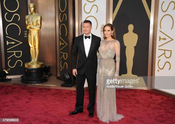 Actors Brad Pitt and Angelina Jolie arrive at the 86th Annual Academy Awards at Hollywood Highland Center on March 2 2014 in Hollywood California