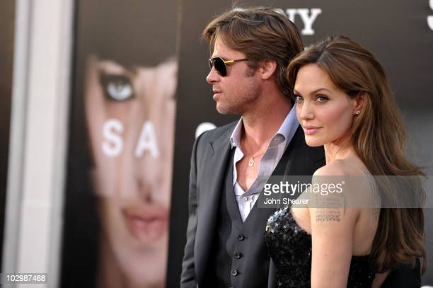 Actors Brad Pitt and Angelina Jolie arrive at the Salt Los Angeles Premiere at Grauman's Chinese Theatre on July 19 2010 in Hollywood California