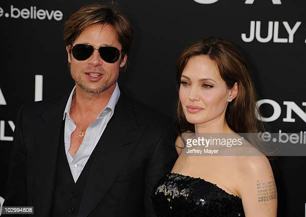"""Actors Brad Pitt and Angelina Jolie arrive at the """"Salt"""" Los Angeles Premiere at Grauman's Chinese Theatre on July 19, 2010 in Hollywood, California."""