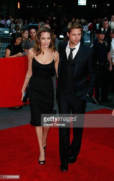 Actors Brad Pitt and Angelina Jolie arrive at the Ziegfeld theater for the US Premiere of the movie The Assassination of Jesse James by the Coward...