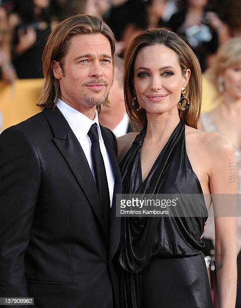 Actors Brad Pitt and Angelina Jolie attend The 18th Annual Screen Actors Guild Awards broadcast on TNT/TBS at The Shrine Auditorium on January 29,...