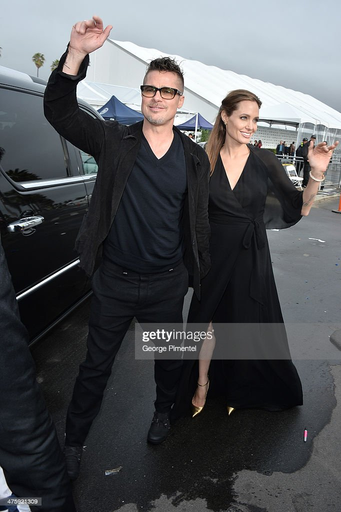 Actors Brad Pitt (L) and Angelina Jolie attend the 2014 Film Independent Spirit Awards at Santa Monica Beach on March 1, 2014 in Santa Monica, California.