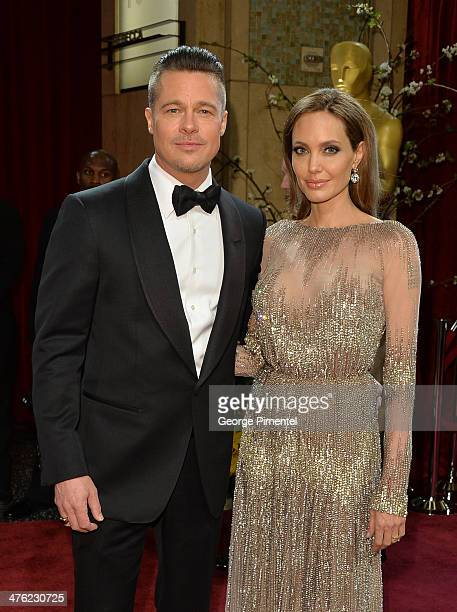 Actors Brad Pitt and Angelina Jolie attend the Oscars held at Hollywood Highland Center on March 2 2014 in Hollywood California