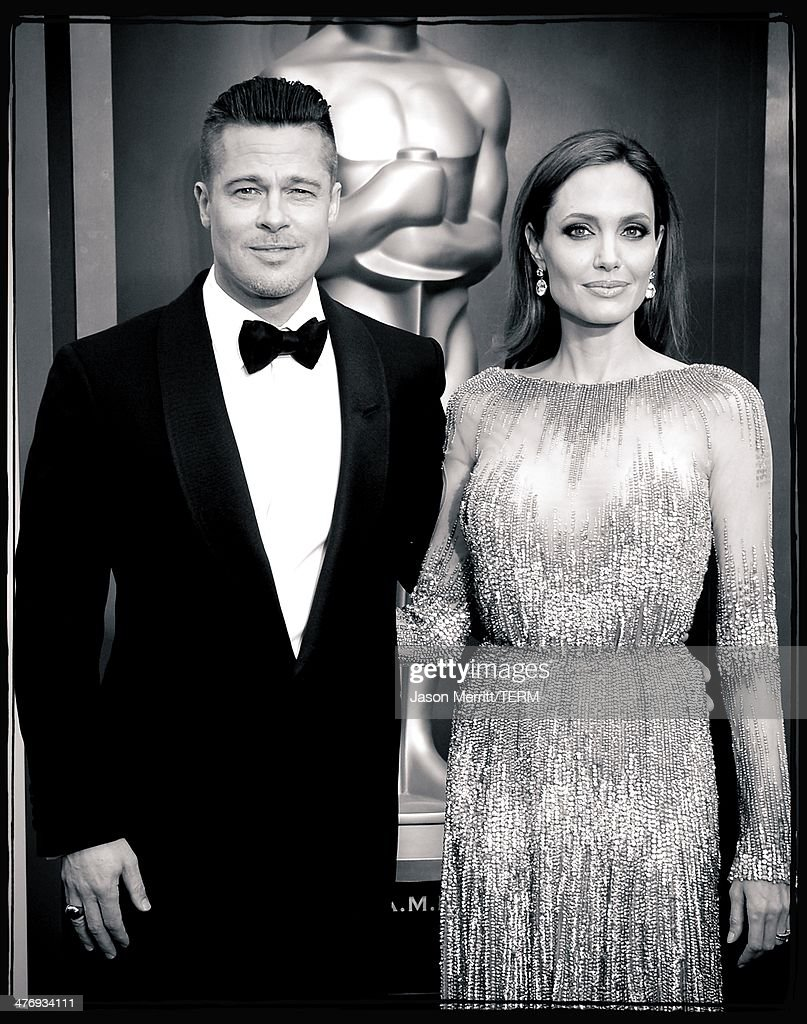 Actors Brad Pitt (L) and Angelina Jolie attend the Oscars held at Hollywood & Highland Center on March 2, 2014 in Hollywood, California.