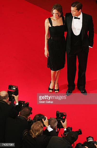 """Actors Brad Pitt and Angelina Jolie attend the premiere for the film """"A Mighty Heart"""" at the Palais des Festivals during the 60th International..."""