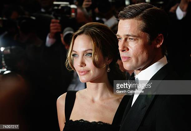 Actors Brad Pitt and Angelina Jolie attend the premiere for the film A Mighty Heart at the Palais des Festivals during the 60th International Cannes...