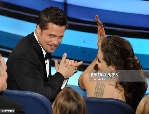 Actors Brad Pitt and Angelina Jolie clap during the 81st Annual Academy Awards held at Kodak Theatre on February 22, 2009 in Los Angeles, California.