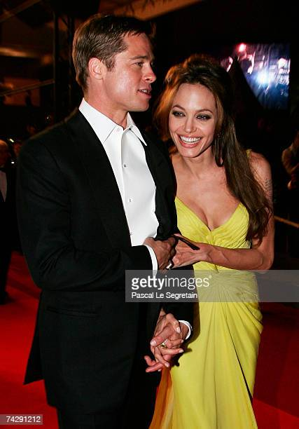 Actors Brad Pitt and Angelina Jolie depart the premiere for the film 'Ocean's Thirteen' at the Palais des Festivals during the 60th International...