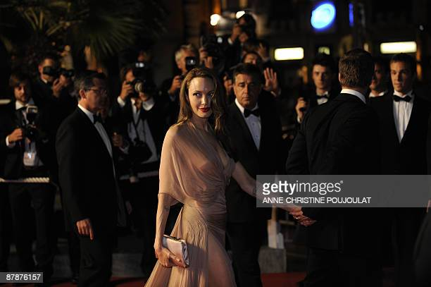 """Actors Brad Pitt and Angelina Jolie leave after the screening of the movie """"Inglourious Basterds"""" directed by Quentin Tarantino, in competition at..."""