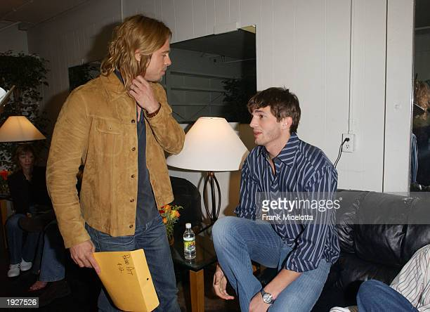 Actors Brad Pitt and Ashton Kutcher mingle backstage during Nickelodeon's 16th Annual Kids' Choice Awards at the Barker Hangar April 12 2003 in Santa...