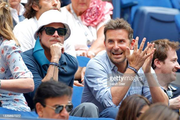 Actors Brad Pitt and Bradley Cooper watch the Men's Singles final match between Daniil Medvedev of Russia and Novak Djokovic of Serbia on Day...